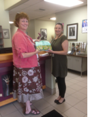 Lisa presenting the packet to Lauren at Nashua School District Central Office